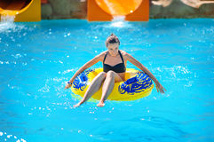 Beautiful girl riding a water slide Royalty Free Stock Photos