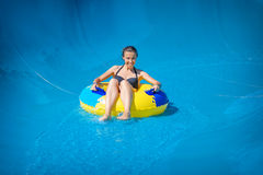 Beautiful girl riding a water slide Royalty Free Stock Photography