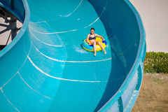 Beautiful girl riding a water slide Stock Photo