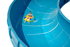 Beautiful girl riding a water slide Stock Photos
