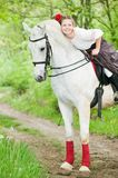 Beautiful girl riding white horse Stock Images