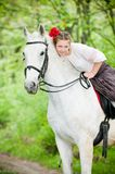 Beautiful girl riding white horse Stock Photos