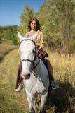 Beautiful girl riding a white horse Royalty Free Stock Photos
