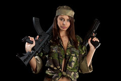 Beautiful girl with a rifle. The beautiful girl with a rifle on a black background Stock Image