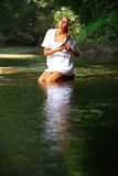 Beautiful girl in river Stock Images