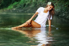 Beautiful girl in river Royalty Free Stock Images