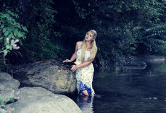 Beautiful girl in the river Royalty Free Stock Photo
