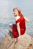 Beautiful girl on the rock Royalty Free Stock Image