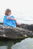 Beautiful girl on a rock between waters Royalty Free Stock Photos