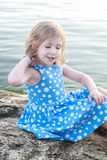 Beautiful girl on a rock between waters Royalty Free Stock Photo