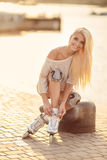 Beautiful girl on roller skates in the park. Royalty Free Stock Images