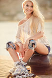 Beautiful girl on roller skates in the park. Royalty Free Stock Photos