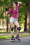 Beautiful girl on rollerblades Stock Photos