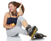 The beautiful girl in rollerskates Royalty Free Stock Images