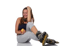The beautiful girl in rollerskates Stock Images