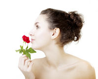 Beautiful girl with a rose. Image of a beautiful girl with a rose Stock Photo