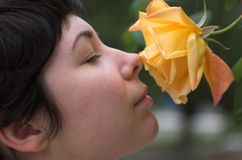 Beautiful girl with a rose 2. Beautiful girl with a yellow rose 2 Royalty Free Stock Images