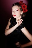 Beautiful girl with rose. In hair Stock Photo