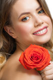 Beautiful girl with rose Stock Photography