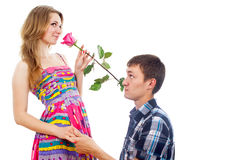 Beautiful girl with a rose and a guy Royalty Free Stock Photos