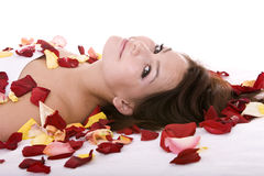 Beautiful girl in rose petal. Royalty Free Stock Image