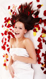 Beautiful girl in rose petal. Isolated. Stock Images