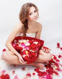 Beautiful girl rose petals Stock Photography