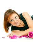 Beautiful girl with a rose and petals Royalty Free Stock Images