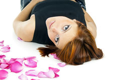 Beautiful girl with a rose and petals Stock Images