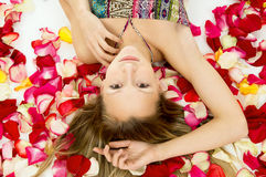 Beautiful girl with rose petals Stock Image