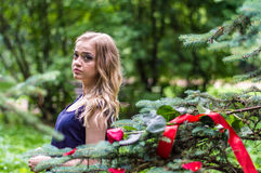 Beautiful girl with rose and red tape. In the park Royalty Free Stock Images