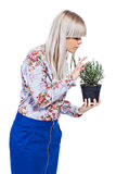 Beautiful girl with a rosemary plant Royalty Free Stock Photo