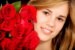 Beautiful girl with roses Stock Photo