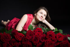 Beautiful girl with roses Royalty Free Stock Images