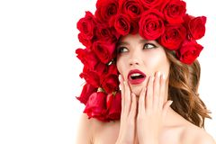 Beautiful girl with roses on head looking surprised stock images