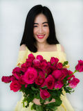 Beautiful girl with roses Stock Images