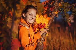 Beautiful girl with Rowan stock photo