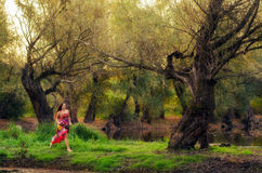 Beautiful girl running barefoot in the spring forest Royalty Free Stock Image