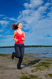 Beautiful girl running at the beach Stock Photo