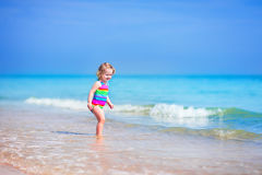 Beautiful girl running on a beach Stock Images