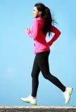 Beautiful girl running on the beach Stock Image