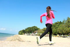 Beautiful girl running on the beach Royalty Free Stock Images
