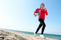 Beautiful girl running on the beach Stock Images