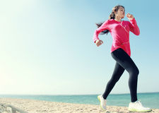 Beautiful girl running on the beach Royalty Free Stock Photo