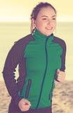Beautiful girl running on beach Stock Photography