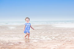 Beautiful girl running on a beach at sunset Royalty Free Stock Photography