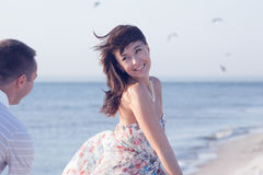 Beautiful Girl running from her boyfriend Stock Image
