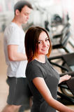 Beautiful girl running on a treadmill Royalty Free Stock Photos