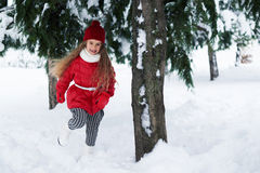 Beautiful girl running under a tree in  winter Stock Photo