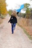 The beautiful girl runs in autumn wood Stock Image